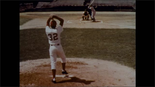 1970s: Pitcher's feet on mound, image freezes. Pitch throws past batter at plate. Pitcher throws pitch, batter in background. Catcher throws ball. Pitcher on mound, drops ball.
