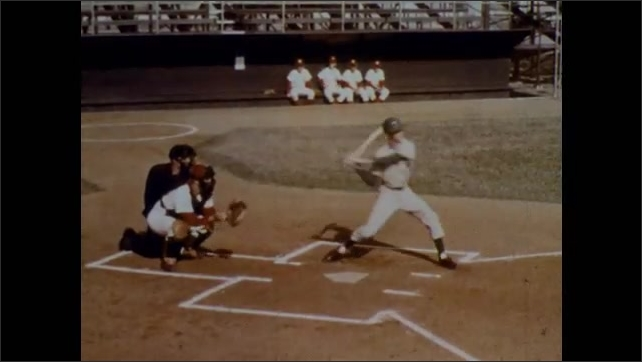 1970s: Close up of baseball glove, zoom out. Close up of baseball. Players run onto field. Pitcher. Batter. Player makes catch. Player throws. Player slides to base. Player hits. Player makes catch.