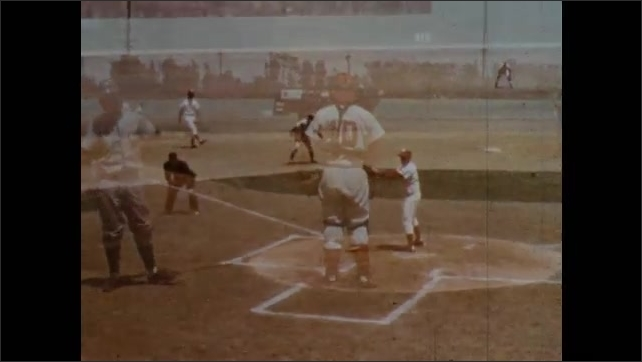 1970s: Player slides to base, zoom in. Umpire runs to field. Players at plate, umpire making call. Long shot of game, pitcher winds up. Catcher throws ball. Player slides to plate. Umpire at plate.