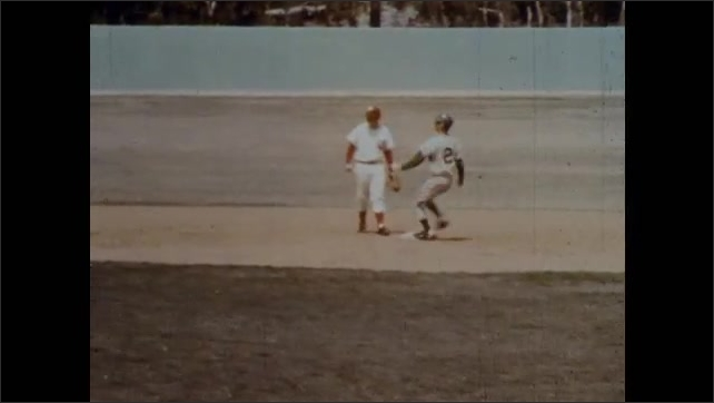 1970s: After a wild pitch, the young batter runs for first base. A runner slides into third and the batter makes it to second. Next pitch goes over the catchers head and is called Ball Four.