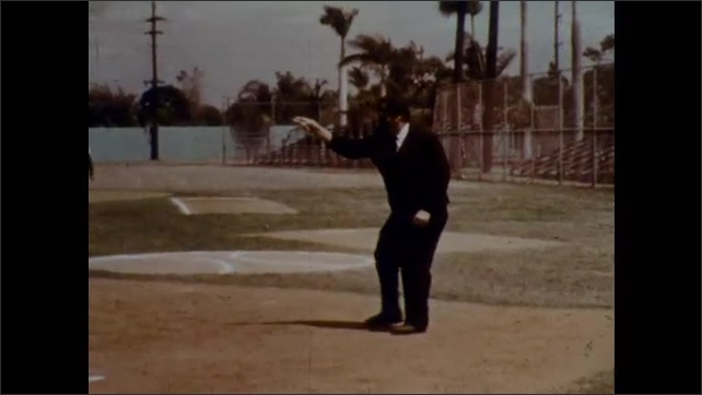 1970s: Batter hits and the fielder throws wide. Ball is dead. Runner runs back to base. Umpire awards two extra bases to the runner. Runners are on base as batter hits the ball.