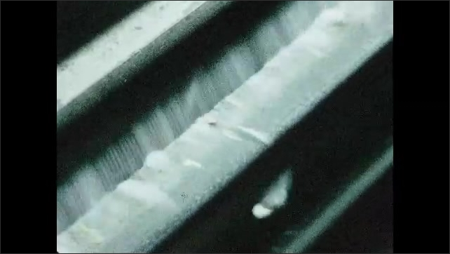 1960s: Close-up of cotton processing.