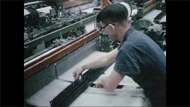 1960s: Man adjusts threads in mechanical loom. Sign on shop door, door opens.
