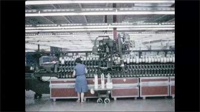 1960s: Woman walks alongside machine, adjusts thread on machine. Door with sign opens.