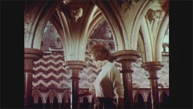 1960s: EUROPE: lady admires roof of historical building.