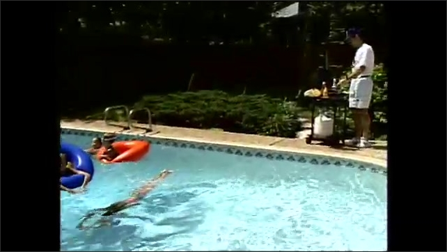 1990s: Children swim and play in pool while man grills nearby.