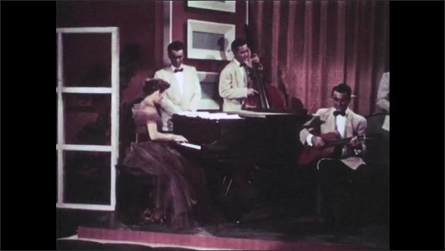 1950s: UNITED STATES: lady sits at piano. Lady plays piano. Lady smiles at audience