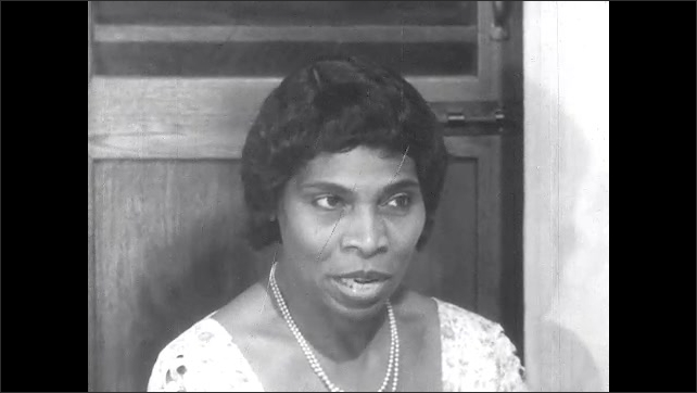 1950s: Marian Anderson and Asian woman sit and talk.