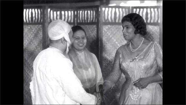 1950s: Marian Anderson and U Nu, Prime Minister of Myanmar talk, shake hands.