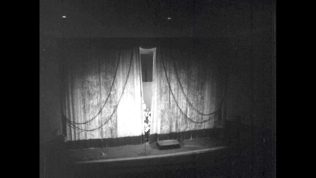 1950s: UNITED STATES: curtains open on Bombay City Orchestra. Lady sings with orchestra