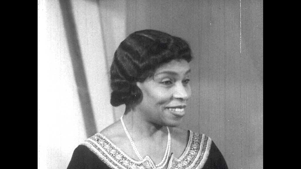 1950s: Radio station.  Woman speaks.