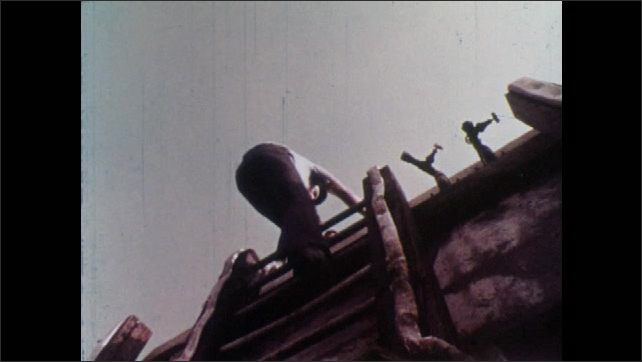 1970s: Man on boat, man and girl look down from dock. Low angle view, man climbs ladder. Men shake hands. Girl looking at men, hands hand over mail. Man talking.