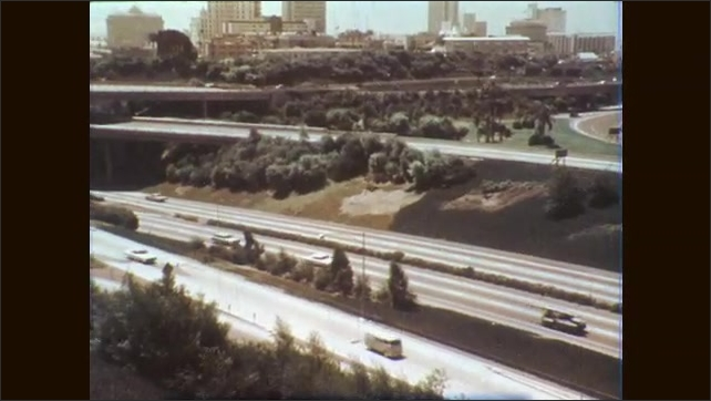 1960s: Speedboats race on lake. Urban planters and landscape on street. Cars on freeway and city skyline. Pristine stream by mountains.
