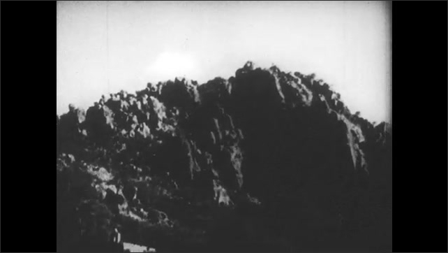SPAIN 1930s: Tree branches, rocky mountains. Ruins of buildings.