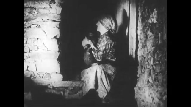 SPAIN 1930s: Man examines child