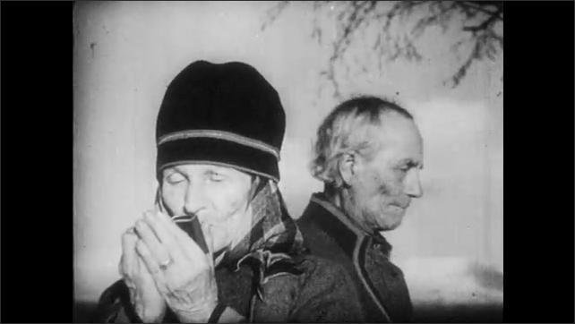 1950s: FINLAND, EUROPE: girl looks for reindeer in herd. Nomadic elders watch reindeer in herd. Man catches reindeer