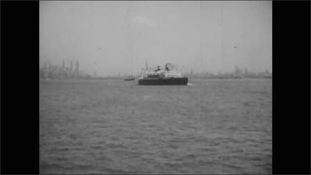 1960s: Ship departs from port, travels across ocean. Steam ship.