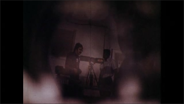 1970s: UNITED STATES: specular reflection of beam. Auxiliary laser equipment, Power supply to laser. Man works in room
