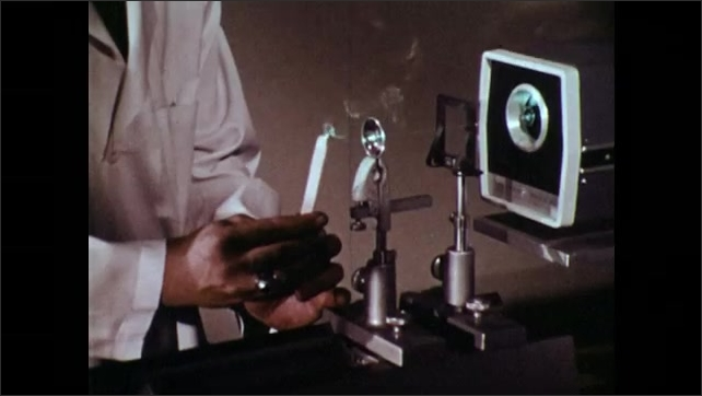 1970s: UNITED STATES: illustration of laser and radiation. Laser beam burns sample material. TB MED 279 guidelines