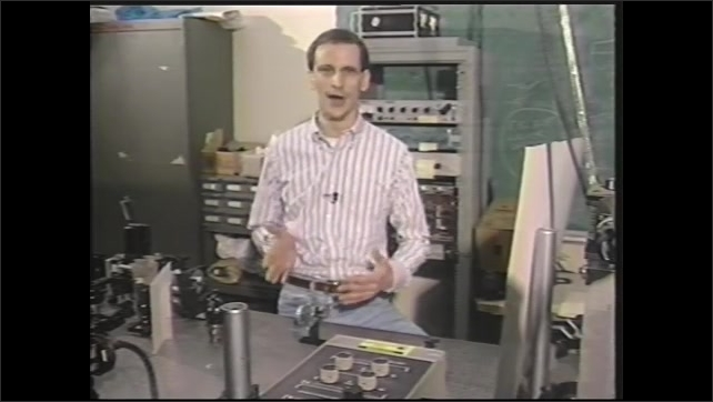 1990s: Man sits in engineering laboratory and speaks.