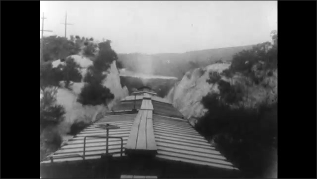 1910s: Woman writes on paper. She grabs hat and runs past desk. Train moves through mountain landscape. Woman gets on horse. Train again.