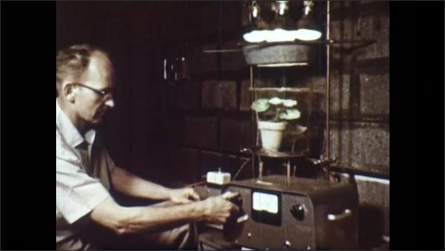 1950s: Chlorophyll fills glass cylinder. Text appears on screen. Scientist turns knob on equipment. Mushroom in dark soil.