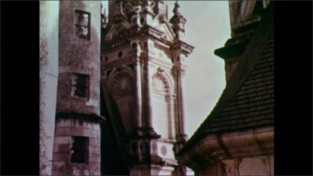 1960s: Woman walks on balcony.  Castle.