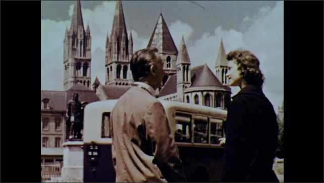 1960s: Man and woman talk in front of cathedral, walk toward cathedral.
