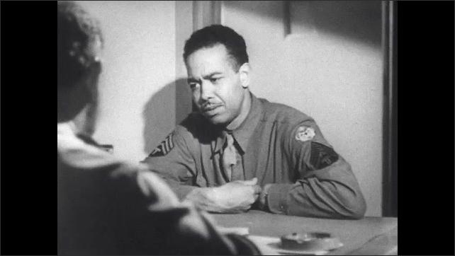 1940s: Soldier is talking. Different soldier sits at table talking to psychiatrist.
