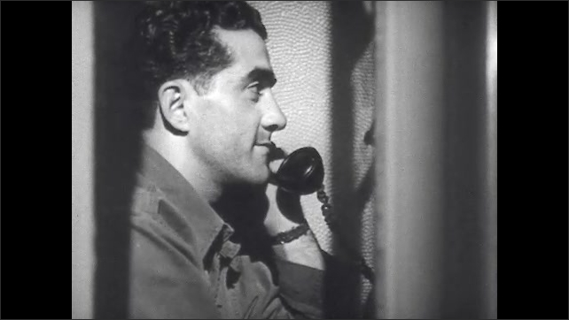 1940s: Men sit in phone booths lined in a row. Soldier sits on bed in hospital room setting picture in frame on bedside table.
