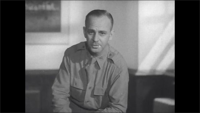 1940s: Therapist speaks to room of male patients in chairs. Therapist in uniform speaks to group.