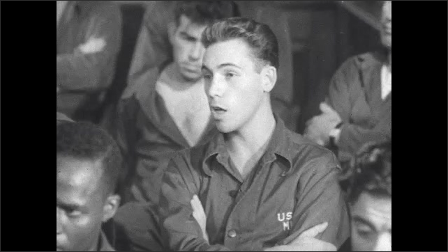 1940s: Male patient in group therapy speaks in seated row.