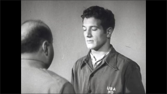 1940s: Face of a man with eyes closed, he listens to the therapist who talks. Therapist talks to man while he has his eyes closed, they both stand in profile.