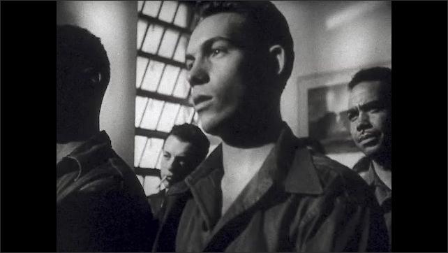 1940s: UNITED STATES: soldiers watch movie in cinema. Man paints rocking horse. Men in theatre.