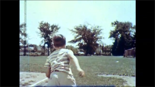 1950s: Boy stands in baseball field, holds baseball, looks around. Boy throws baseball into outfield, runs after ball. Boy stands in kitchen, holds out arms. Woman looks at sleeves of boy's jacket.