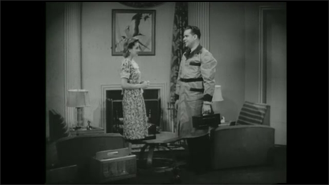 1990s: Man and woman speak in living room.  Control panel.  Robot hands hat to man.  Astronaut speaks in space.