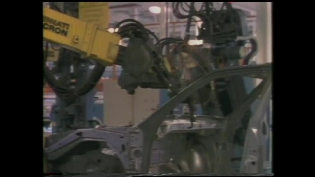 1990s: Automated arm moves in space.  Earth's surface.  Machine.  Traffic light.  Forklift moves barrels.  Van moves down assembly line.