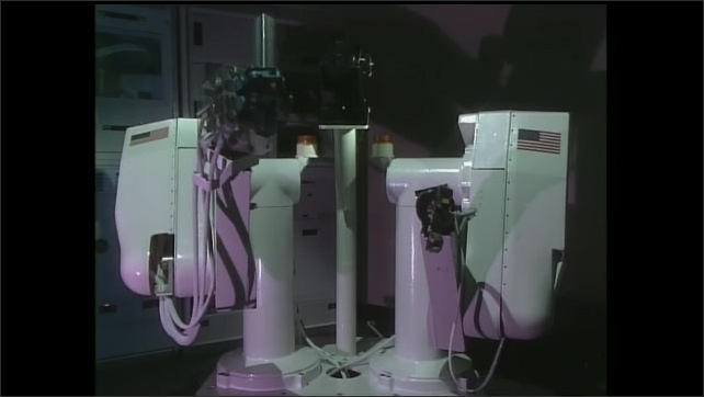 "1990s: Machine moves robotic arm.  The text ""Articulate"" moves across the screen."