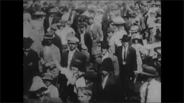 1920s: Teddy Roosevelt shakes hands with Native Americans on horseback.  Men on train wave to crowd.  Men on horses ride on train tracks.