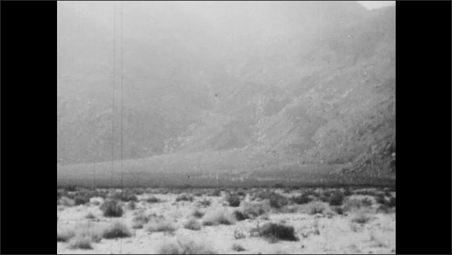 1940s: Mountain.  Cloud.  Rain falls.