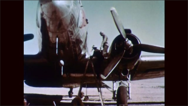 1950s: NORTH AFRICA: cargo truck carries supplies in Sahara desert. Plane in Sahara desert. People get on plane in desert