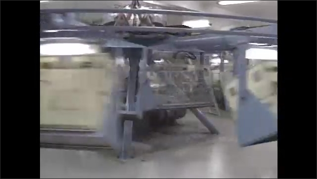 1990s: Machine designed to hold animals in centrifuge spins around in circle in room.