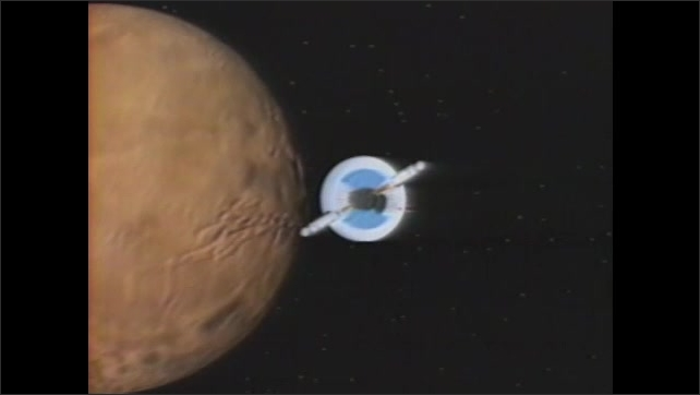 1990s:??Animation of spacecraft flying past Mars. Astronauts on exterior of spaceship assembling pieces. Two men help man in partial space suit to his feet.??