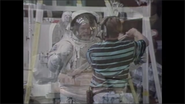 1990s:??Astronaut is physically tested with electrodes attached to chest. Ultrasound readout. Scientists in plant lab, looking at wheat stalk. Astronaut in spacesuit. Surface of moon.??