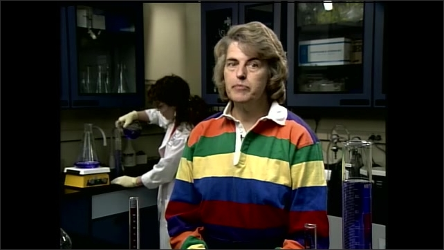 1990s: Woman sits in bio-chemical lab and speaks. Man floats through Spacelab and speaks. Woman speaks in laboratory while scientist works in the background.