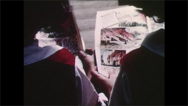 1950s: Smokey the bear sign inside bus. Boy scouts looks at poster on tree. Kids look at ad in comic book.