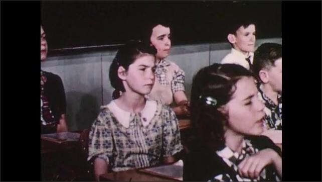 1950s: Kids sit at desks and sing.