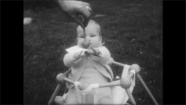 1950s: Students sit in lecture hall. Baby tries to grab toy from hand that moves in front of baby. A man drunk tries to open door. Hand tries to fit a key in door lock, after several tries succeeds.