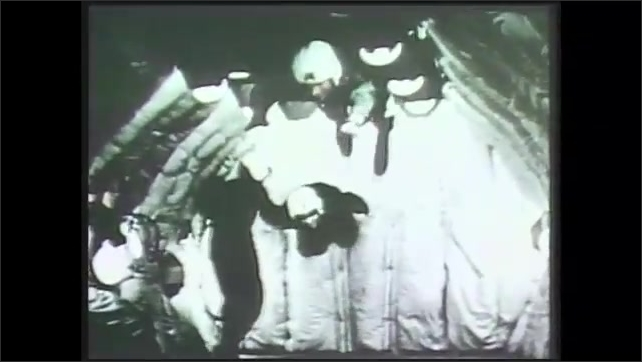 1990s: Space shuttle lifts off. Mission control. Astronaut enters capsule. Equipment rotates. Astronauts float. Men in front of terminal. Astronaut in uniform. Man seated at terminal.