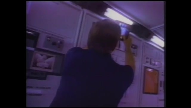 1990s: Machine.  Man oversees people working on computers.  Astronauts work in space.  Man works in lab.